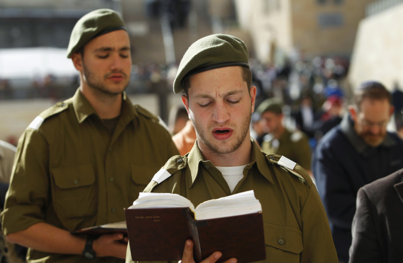 Israeli soldiers pray at the Western Wall. (photo credit: BAZ RATNER/REUTERS)