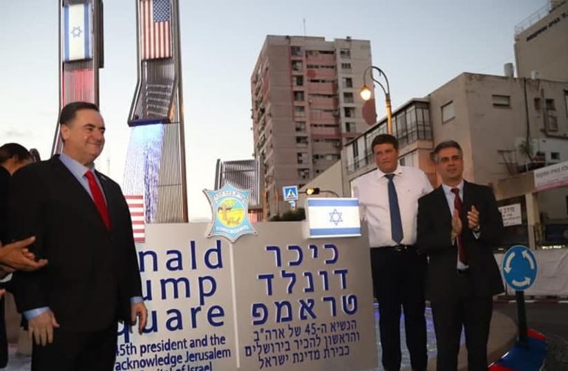 Foreign Minister Yisrael Katz [L] standing next to the sign of Trump Square in Petah Tikva   (photo credit: PETAH TIKVA MUNICIPALITY)