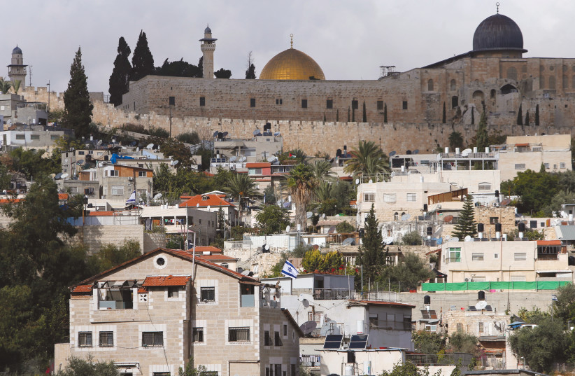 The Dome of the Rock and al-Aqsa mosque are seen from Silwan. (photo credit: REUTERS/AMMAR AWAD)