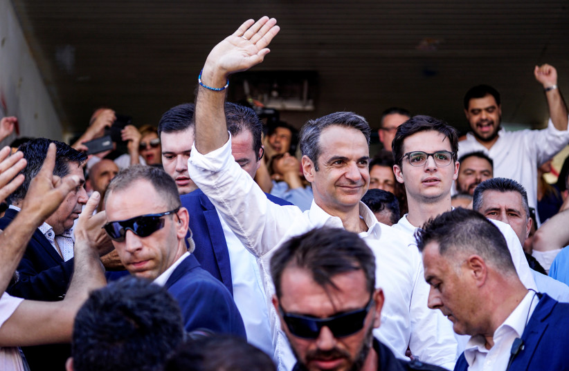 New Democracy conservative party leader Kyriakos Mitsotakis waves at supporters after voting at a polling station, during the general election in Athens, Greece, July 7, 2019. (photo credit: REUTERS)