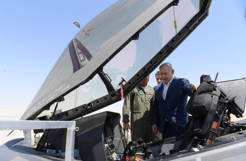 Prime Minister Benjamin Netanyahu checks out an F-35 jet (photo credit: AMOS BEN-GERSHOM/GPO)