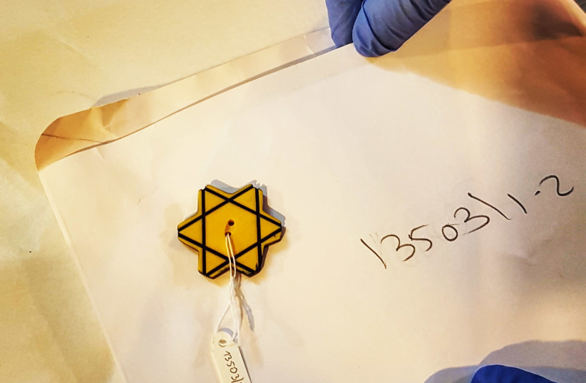 A yellow button shaped like a Star of David worn by the Jews of Bulgaria during the Holocaust (photo credit: ILANIT CHERNICK)