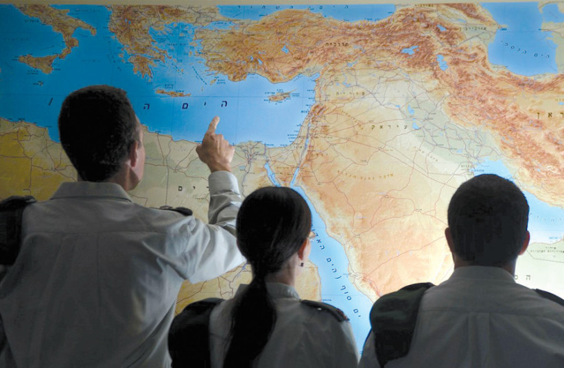 IDF OFFICERS examine a map of the Middle East. (photo credit: IDF SPOKESPERSON'S UNIT)