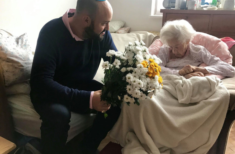From the Depths founder Jonny Daniels sits with the oldest living Righteous Among the Nations Krystyna Dańko on her 102nd birthday (photo credit: FROM THE DEPTHS)