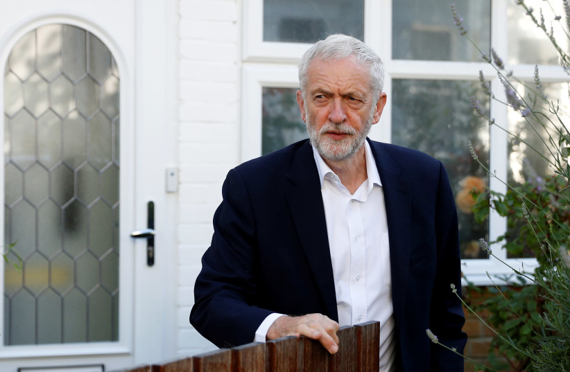 Britain's opposition Labour Party leader Jeremy Corbyn leaves his home in London, Britain earlier this month (photo credit: PETER NICHOLLS/REUTERS)