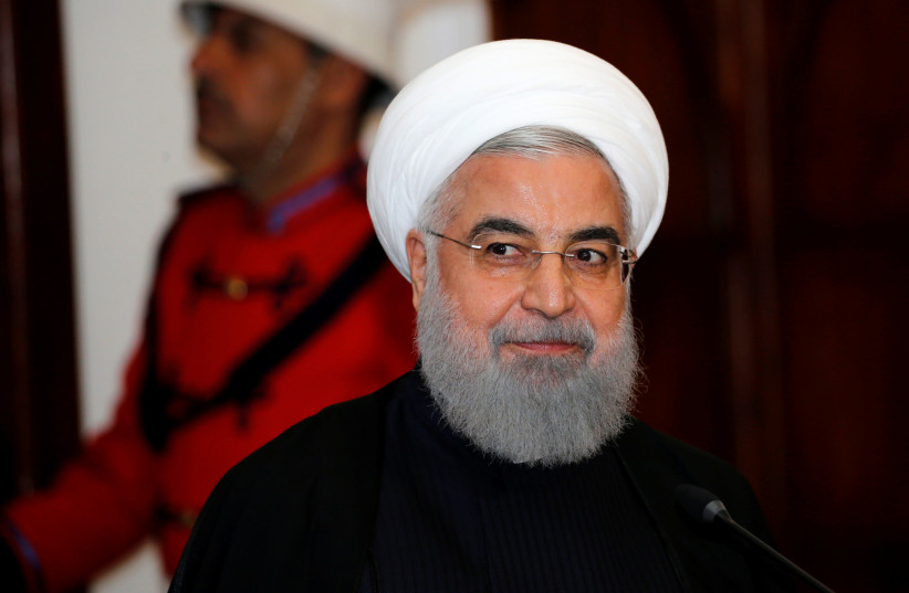 Iranian President Hassan Rouhani speaks during a news conference  at Salam Palace in Baghdad, Iraq March 11, 2019 (photo credit: THAIER AL-SUDANI/REUTERS)