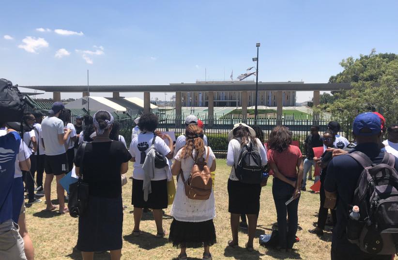 Ethiopian-Israelis protest outside Knesset July 15, 2019 (photo credit: BRADLEY LEVIN)