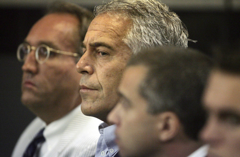 U.S. financier Jeffrey Epstein (C) appears in court where he pleaded guilty to two prostitution charges in West Palm Beach, Florida, U.S. July 30, 2008. Picture taken July 30, 2008.   (photo credit: UMA SANGHVI/PALM BEACH POST VIA REUTERS)