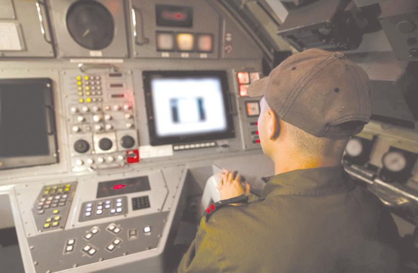 A cadet trains in a simulator of a submarine. (photo credit: IDF)