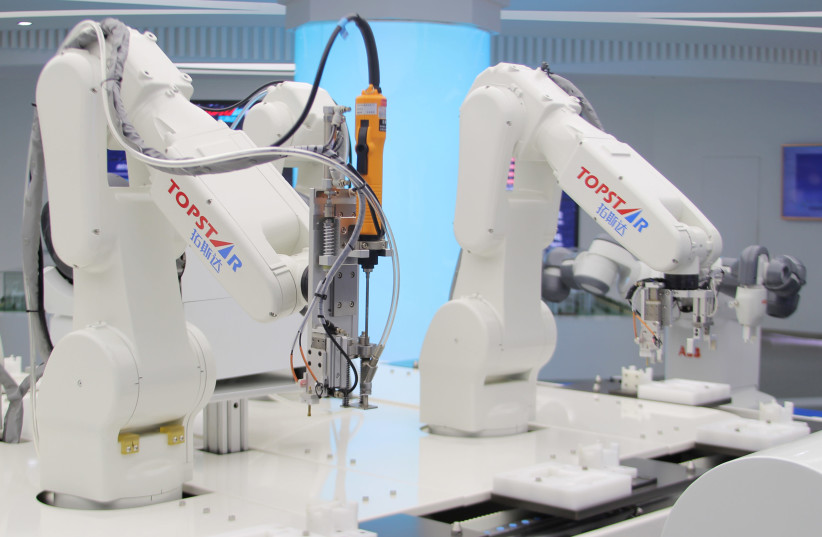 Industrial robots are pictured at a factory of Topstar Technology during a government-organised tour to the Guangdong-Hong Kong-Macao Greater Bay Area, in Dongguan (photo credit: REUTERS)