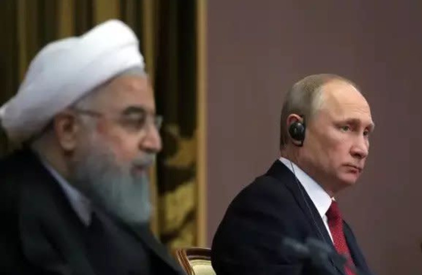 Iran's President Hassan Rouhani together with Russia's Vladimir Putin attend a joint news conference following their meeting in Sochi, Russia November 22, 2017  (photo credit: SPUTNIK/MIKHAIL KLIMENTYEV/KREMLIN VIA REUTERS)