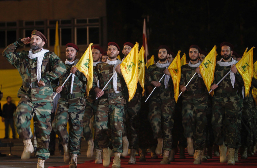 Members of Hezbollah march with party's flags during a rally marking al-Quds Day, (Jerusalem Day) in Beirut (photo credit: REUTERS)