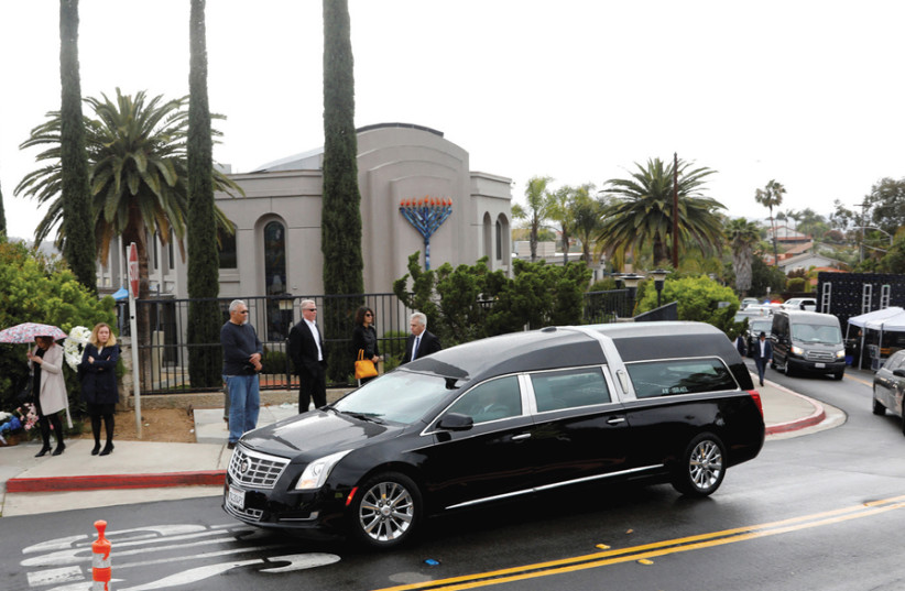 A HEARSE carrying the body of Lori Gilbert- Kaye, the sole fatality of the April 27 synagogue shooting that also left three injured, leaves the Chabad of Poway in San Diego, California, on April 29. Nineteen-yearold white supremacist John T. Earnest shot up the Chabad in a copycat attack inspired by (photo credit: JOHN GASTALDO/REUTERS)