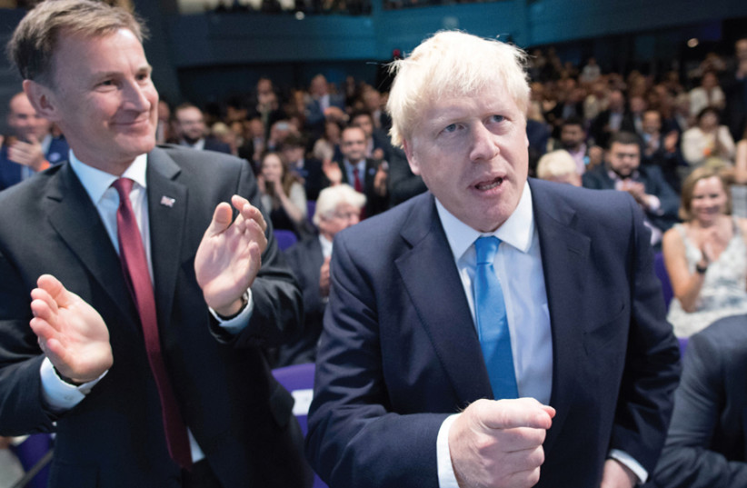 BRITISH SECRETARY of State for Foreign and Commonwealth Affairs Jeremy Hunt (left) congratulates Boris Johnson after it was announced that Johnson was the new Conservative Party leader and would become the next prime minister, at the Queen Elizabeth II Centre in London on July 23. (photo credit: STEFAN ROUSSEAU/REUTERS)