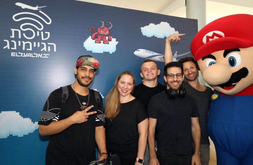 Gamers Shlomi Ben Atar, Eyal Yossef, Guy Podolitch and Ben Keysar with El Al Director of Marketing Adi Hanegby (photo credit: SIVAN FARAG)
