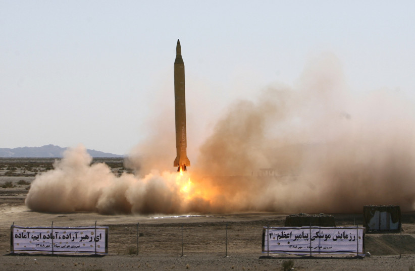 A Ghadr 1 class Shahab 3 long range missile is prepared for launch during a test from an unknown location in central Iran (photo credit: REUTERS)