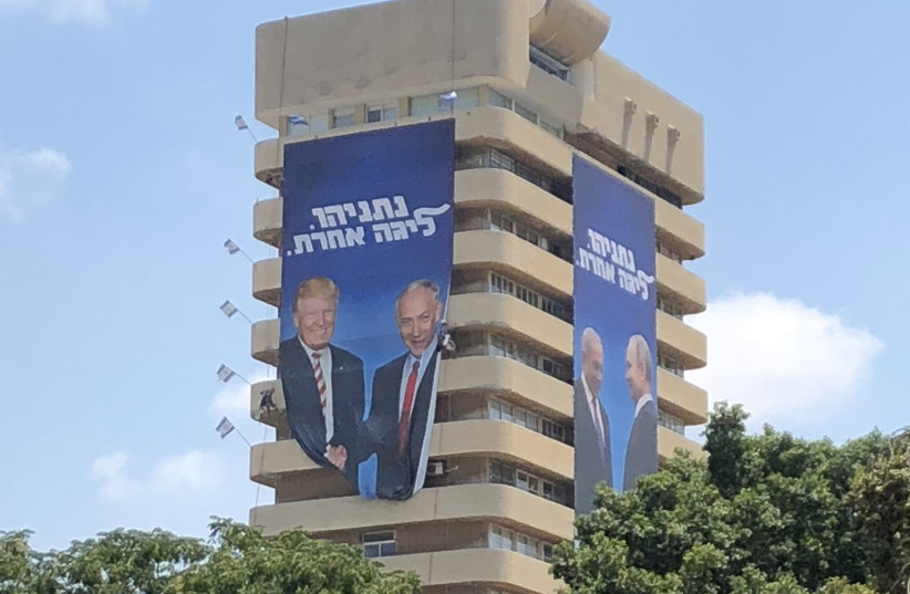 The new Likud posters show Prime Minister Benjamin Netanyahu with Vladimir Putin and Donald Trump (photo credit: ANNA AHRONHEIM)