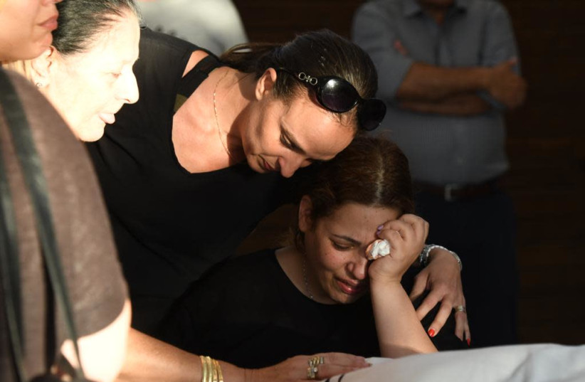 Dikla Hisdai, the widow of Ofir Hisdai, her husband was shot down in an argument over parking space. The funeral was on Monday in Ramle.   (photo credit: AVSHALOM SASSONI/ MAARIV)