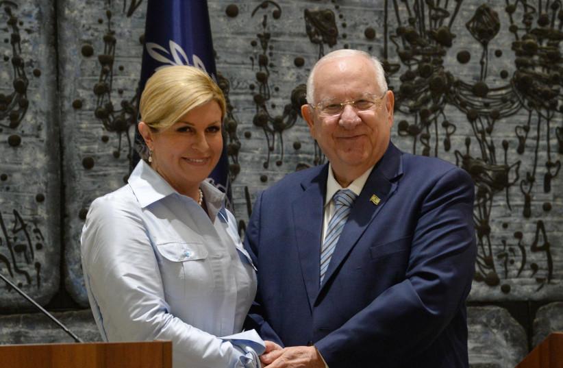 President Reuven Rivlin held a state reception for Croatian President Kolinda Grabar-Kitarović who visits Israel (photo credit: MARC NEYMAN/GPO)