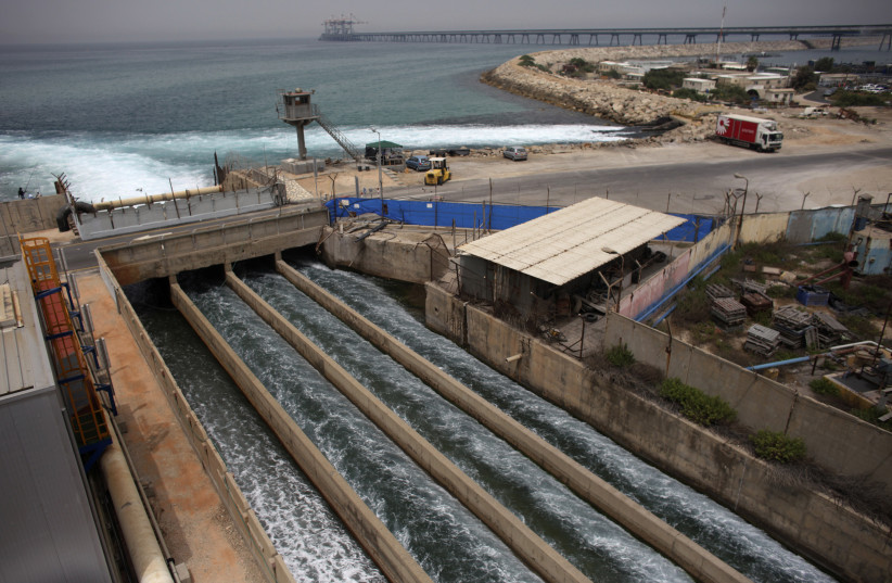 Brine water flows into the Mediterranean Sea after passing through a desalination plant in the coastal city of Hadera (photo credit: NIR ELIAS / REUTERS)