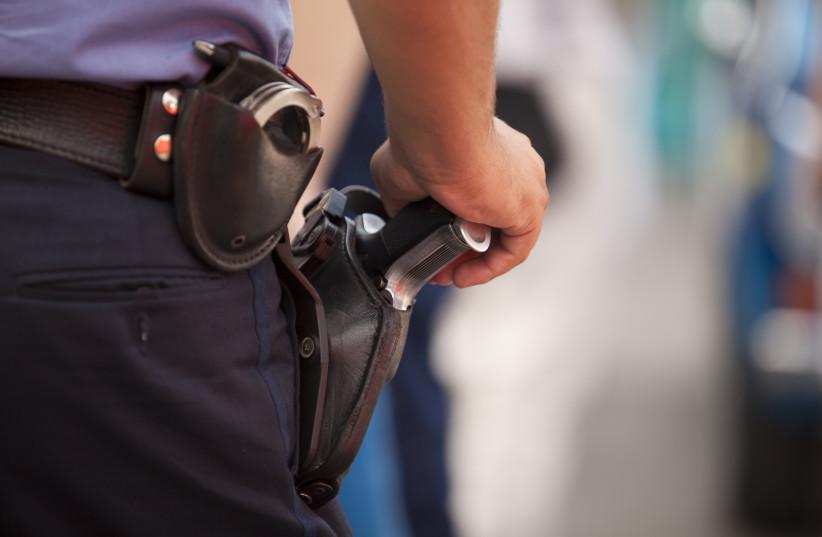 Police  (photo credit: ING IMAGE/ASAP)