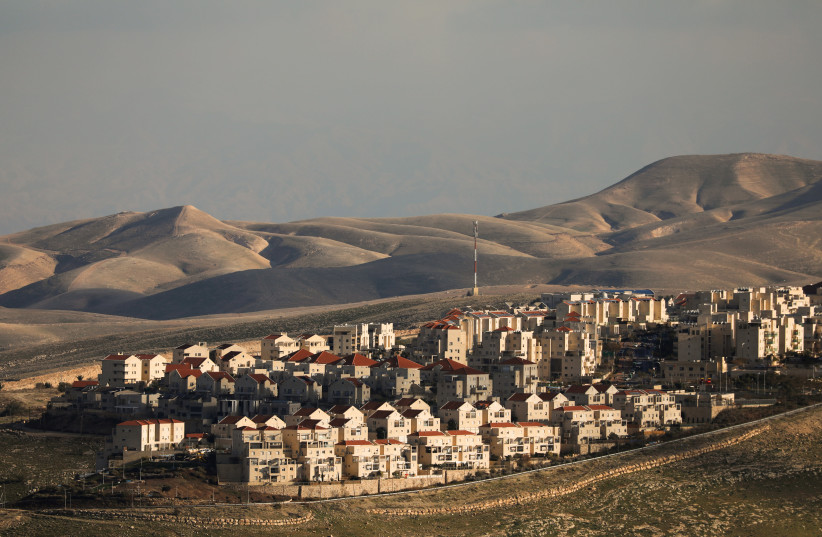 A general view picture shows houses in the Israeli settlement of Maale Adumim, in the West Bank February 15, 2017 (photo credit: AMMAR AWAD/REUTERS)