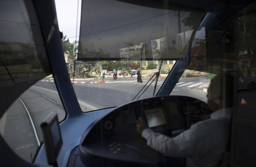 A light railway driver drives a tram in Jerusalem (photo credit: REUTERS/Ronen Zvulun)