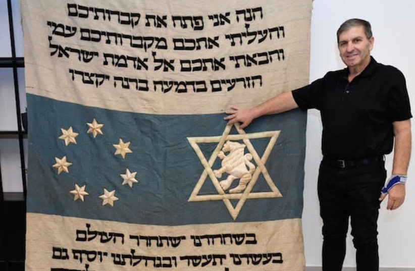 Danny Atar, head of KKL-JNF with the parochet (photo credit: JORGE NOVOMINSKI)