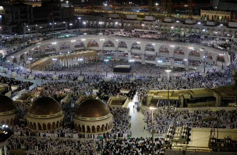 Muslims pray at the Grand Mosque during the annual Haj pilgrimage in the holy city of Mecca, Saudi Arabia August 6, 2019 (photo credit: UMIT BEKTAS / REUTERS)