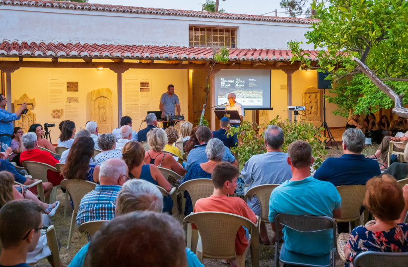 Attendees of the special exhibition opening for the ancient Synagogue mosaic on Aegina Island in Greece (photo credit: ECOWEEK)