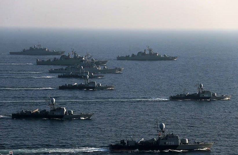 Iranian Navy ships on a training exercise (photo credit: Wikimedia Commons)