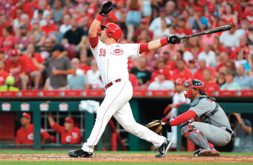 FORMER TEAM ISRAEL catcher Ryan Lavarnwaycrushes one of the two home runs he hit in his Cincinnati Reds debut last month, his first of five games with the MLB club before being sent back to the minors. (photo credit: REUTERS)