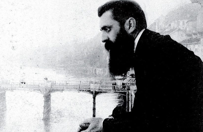 Theodor Herzl leaning over the balcony of the Hotel Les Trois Rois in Basel, Switzerland, probably during the Sixth Zionist Conference there in 1903 (photo credit: JERUSALEM POST ARCHIVE)