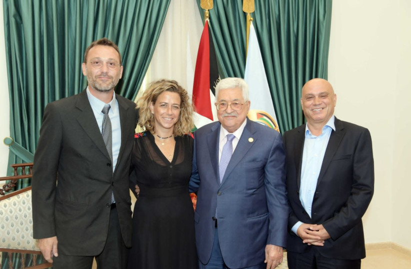 Palestinian leader Mahmoud Abbas greets former prime minister Yitzhak Rabin's grandaughter, Democratic Union Knesset candidate Noa Rothman and her husband, Eldad Rothman (left) and MK Essawi Frej  at his office in Ramallah (photo credit: DEMOCRATIC UNION)