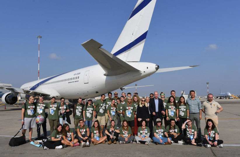 242 new immigrants stepped off a Nefesh B'Nefesh chartered El Al flight in Ben-Gurion Airport on August 14, 2019. (photo credit: GPO)