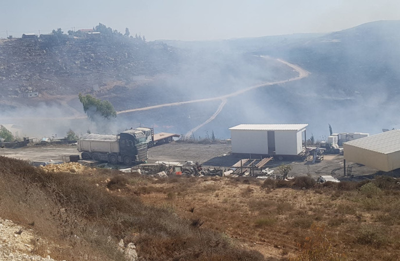 Fire in the West Bank settlement of Yitzhar (photo credit: NATHANAEL KAUFMAN/TPS)