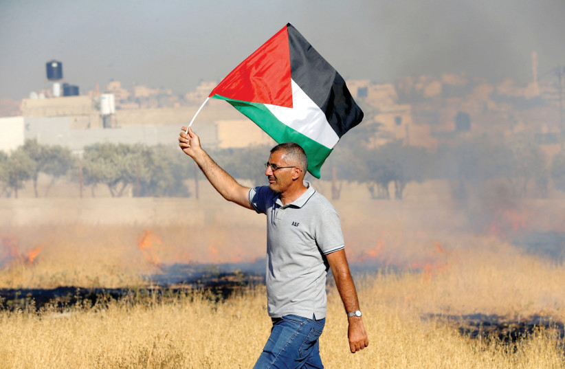 IRONICALLY, ALTERNATIVES to a two-state solution don't necessarily provide any sort of protection from the violence against Israel. (photo credit: REUTERS)