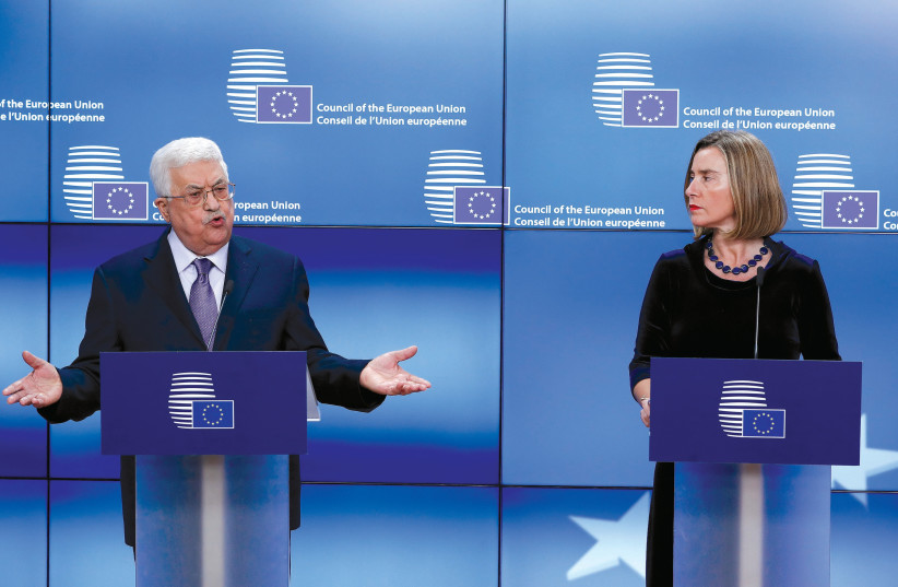 PALESTINIAN AUTHORITY President Mahmoud Abbas meets with European Union foreign policy chief Federica Mogherini (photo credit: REUTERS)