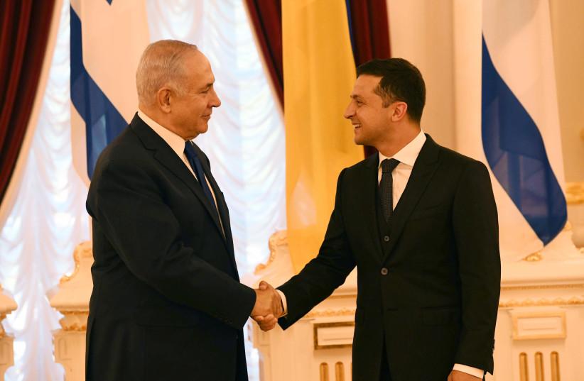 Prime Minister Benjamin Netanyahu meets with Ukrainian President Volodymyr Zelensky (photo credit: AMOS BEN GERSHOM, GPO)