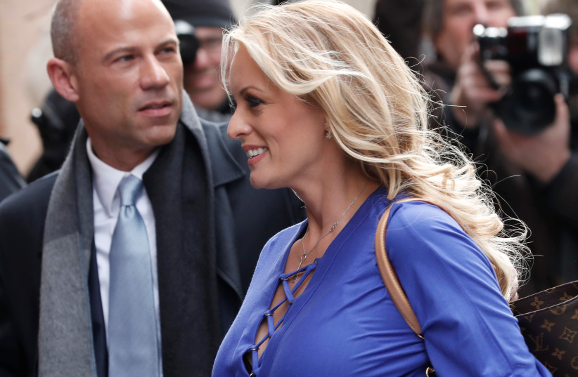 Adult-film actress Stephanie Clifford, also known as Stormy Daniels, arrives with her attorney Michael Avenatti (L) at ABC studios to appear on The View talk show in New York City, New York, U.S. (photo credit: REUTERS/MIKE SEGAR)