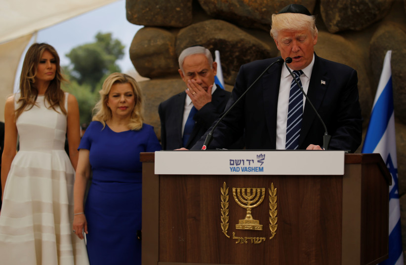 US President Donald Trump wears a kippah while delivering a speech at Yad Vashem in 2017 (photo credit: JONATHAN ERNST / REUTERS)