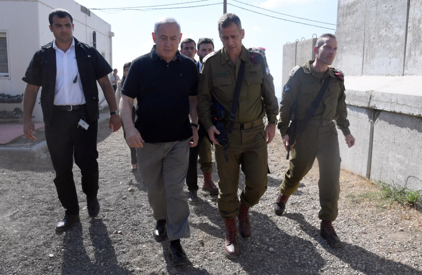 Prime Minister and Defense Minister Benjamin Netanyahu meets with senior IDF officials in the North, August 25, 2019 (photo credit: HAIM ZACH/GPO)