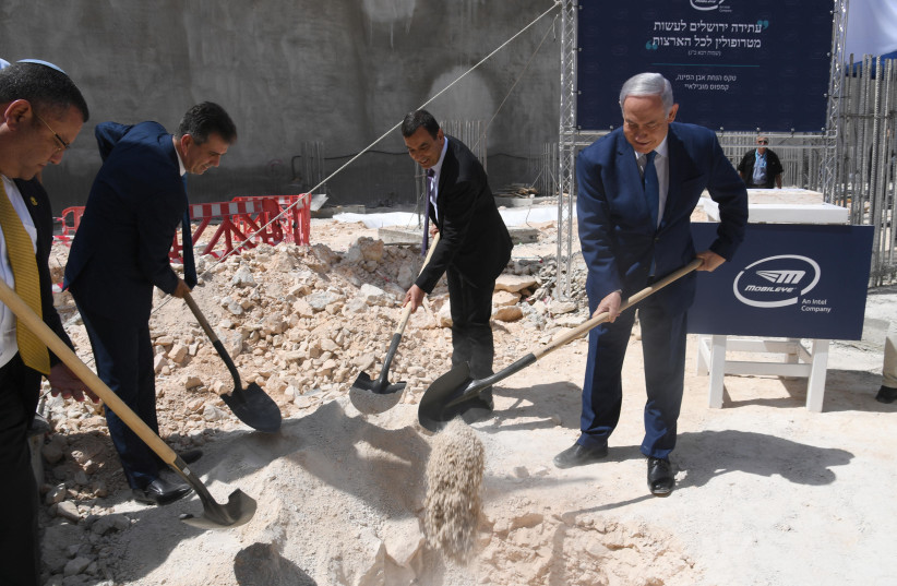 Prime Minister Benjamin Netanyahu, Mobileye founder Prof. Amnon Shashua, Economy Minister Eli Cohen, and Jerusalem Mayor Moshe Lion partake in the cornerstone laying of the new Mobileye global development center in Jerusalem (photo credit: HAIM ZACH/GPO)