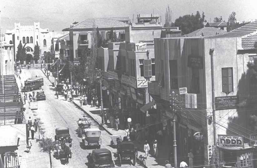 HERZL STREET in 1934, during Tel Aviv's early years. The city is named after Herzl's seminal work 'Altenuland'; 'Tel Aviv' is the title of the Hebrew translation of 'Altneuland.' (photo credit: Wikimedia Commons)