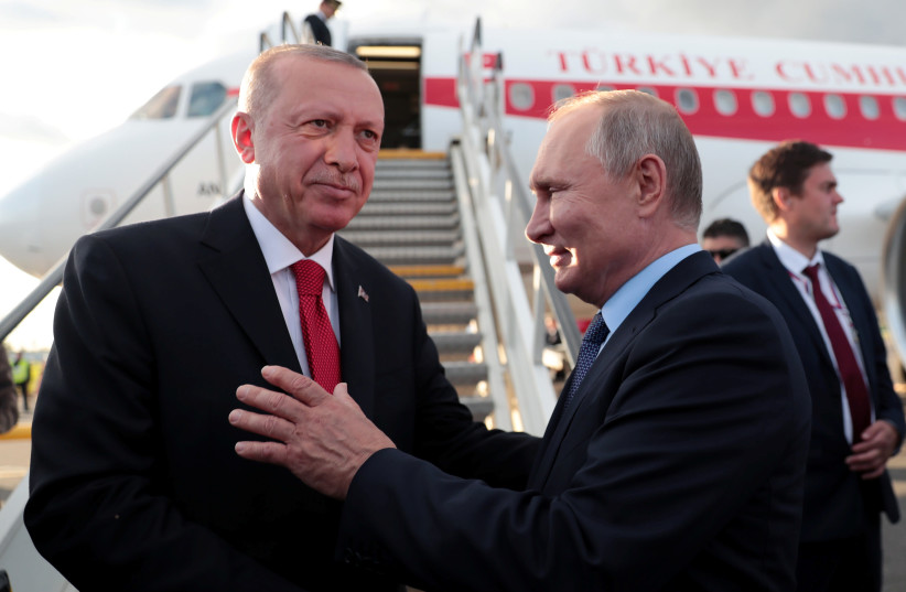 Turkish President Tayyip Erdogan chats with his Russian counterpart Vladimir Putin before his departure at Zhukovsky Airport near Moscow, Russia, August 27, 2019. (photo credit: MURAT CETINMUHURDAR/PRESIDENTIAL PRESS OFFICE/HANDOUT VIA REUTERS)