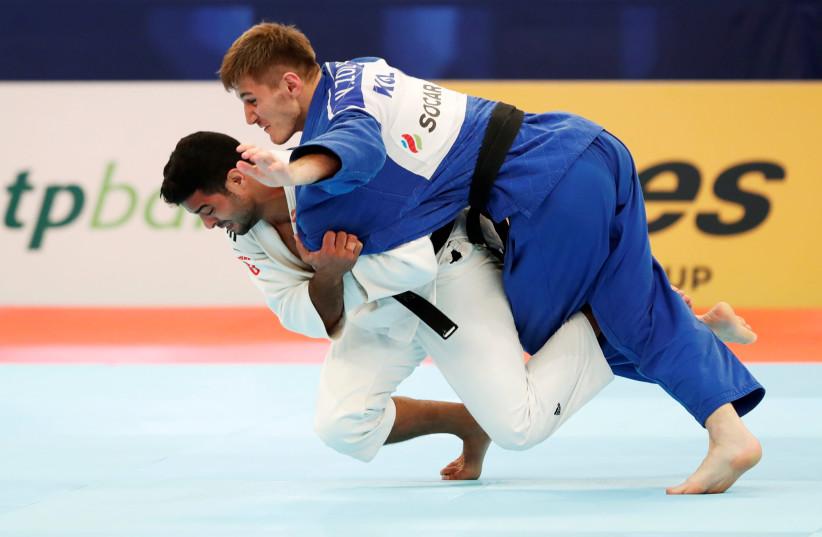 Judo - World Judo Championships - Men's Under 81 kg - Nippon Budokan, Tokyo, Japan - August 28, 2019 - Israel's Sagi Muki and Kyrgyzstan's Vladimir Zoloev compete (photo credit: REUTERS/KIM KYUNG-HOON)