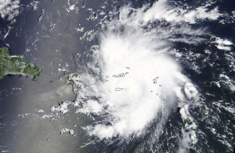 Handout photo of Hurricane Dorian is shown as it nears St. Thomas and the U.S. Virgin Islands (photo credit: NASA WORLDVIEW AND EOSDIS/HANDOUT VIA REUTERS)