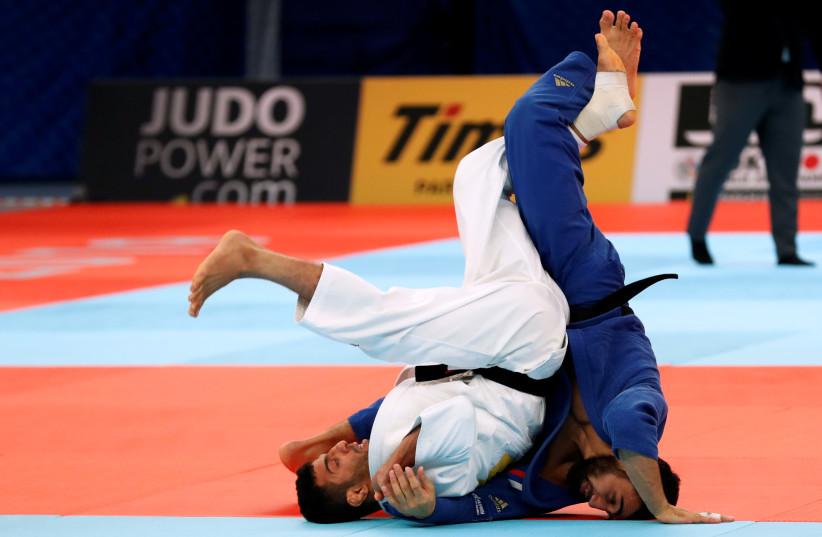 Judo - World Judo Championships - Men's Under 81 kg - Nippon Budokan, Tokyo, Japan - August 28, 2019 - Iran's Saeid Mollaei and Russia's Khasan Khalmurzaev compete.  (photo credit: REUTERS)