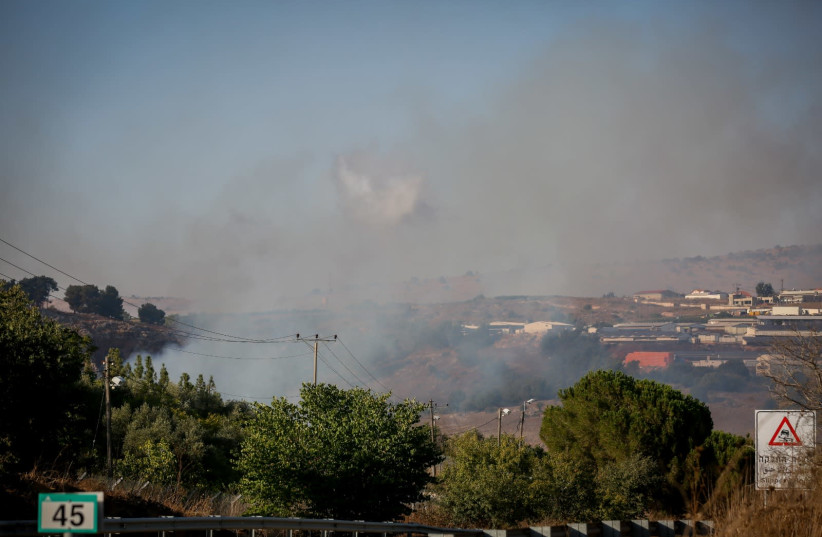 Smoke rises near Moshav Avivim near the border between Israel and Lebanon, in northern Israel, September 1, 2019. Photo by David Cohen/Flash90 (photo credit: DAVID COHEN/FLASH 90)