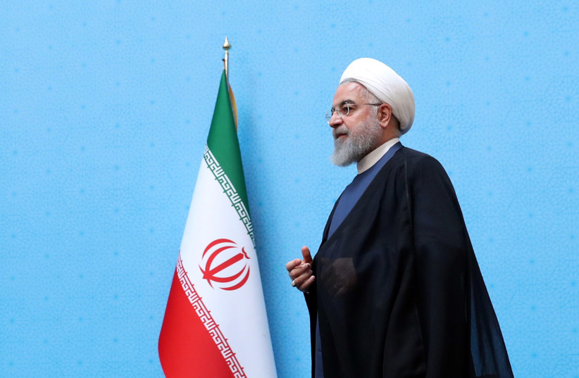 Iranian President Hassan Rouhani walks to deliver a speech during the Conference of Government's Achievements in Developing Rural Infrastructure in Tehran, Iran, August 26, 2019.  (photo credit: PRESIDENT.IR/HANDOUT VIA REUTERS)